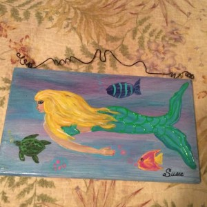 green mermaid plaque